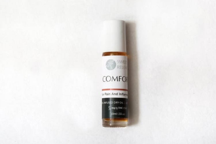 cannabis topicals Comfort Warms Dry Oil by Sweet Releaf